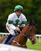 Gaelic Spirit ridden by Josephine Gordon go down to the start of the first race during Afternoon Racing at Salisbury Racecourse on 18th May 2017