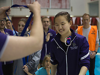 NWA Democrat-Gazette/CHARLIE KAIJO Fayetteville's Kexin Mens accepts her award for the girls 100 yard freestyle during a swim meet, Saturday, February 9, 2019 at the University of Arkansas HYPER pool in Fayetteville.