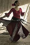 A female dancer alone, dancing in a ruined home.