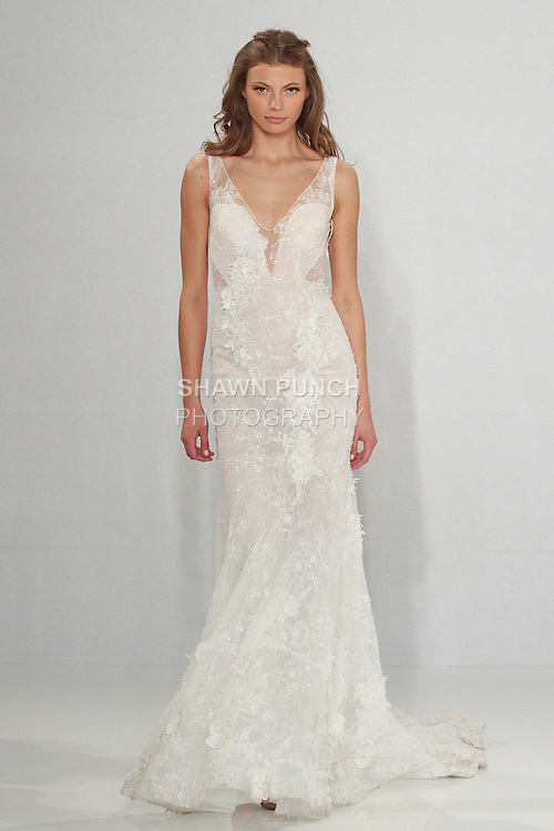 "Model walks runway in Ivy - an off white mermaid-cut hand embroidered lace dress with V-neckline, from the Tony Ward Fall 2016 ""A Mid-Summer Night's Dream"" bridal collection on April 18, 2016 at Kleinfeld Bridal during New York Bridal Fashion Week Spring Summer 2016."