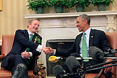 United States President Barack Obama shakes hands with Prime Minister (Taoiseach) Enda Kenny of Ireland in the Oval Office of the White House in Washington, D.C. on March 17, 2015. <br /> Credit: Dennis Brack / Pool via CNP