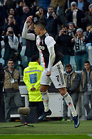 6th January 2020; Allianz Stadium, Turin, Italy; Serie A Football, Juventus versus Cagliari; Cristiano Ronaldo of Juventus celebrates as he scores the goal for 2-0 for Juventus from a penalty kick in the 67th minute - Editorial Use