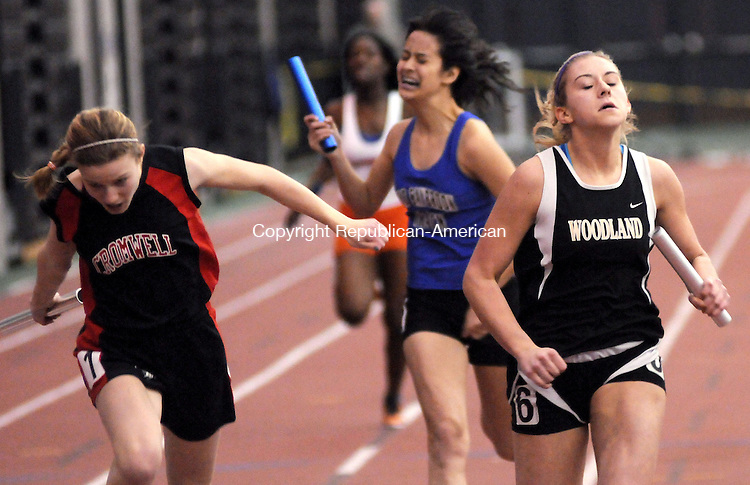 NEW HAVEN, CT, 10 FEBRUARY 2011-021011JS12--Woodland's Tayler Boncal, right finishes strong as the anchor the 4x200 relay during the State Class S Indoor Track and Field Championships Thursday at the New Haven Athletic Center in New Haven, <br /> Jim Shannon Republican-American