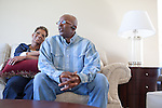DNA Exonerated prisoner Thomas McGowan, right, sits next to his girlfriend Kim Moses in his home in Garland, Texas.