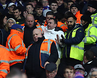 31st January 2020; Cardiff City Stadium, Cardiff, Glamorgan, Wales; English Championship Football, Cardiff City versus Reading; A Reading fan is escorted out of the ground by stewards during the first half
