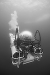 Cocos Island, Costa Rica; the DeepSee submarine fully submerged below ocean's surface, venting air bubbles to control it's buoyancy as it resurfaces