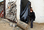 Dutch artist Marjan Teeuwen speaks with her assistant as she creates an architectural work that involves re-assembling wreckage of a house, that was destroyed during 2014, and turning it into artistic structures, in Khan Younis in the southern Gaza Strip December 14, 2016. Photo by Abed Rahim Khatib