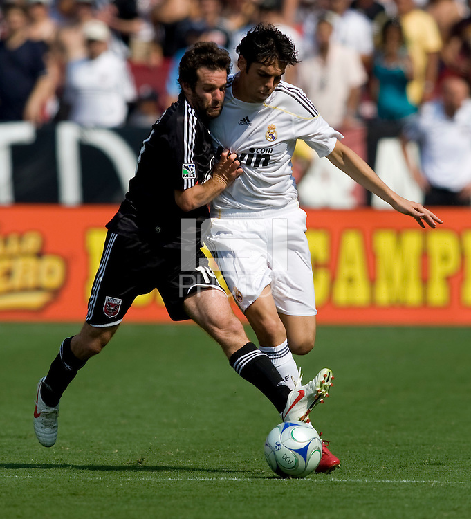 Real Madrid forward (8) Kaka fights for the ball with DC United midfielder (14) Ben Olsen during their friendly at FedEx Field in Landover, Maryland.  Real Madrid defeated DC United, 3-0.