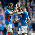 Bilel Mohsni celebrates with Lee Wallace after scoring goal no 8