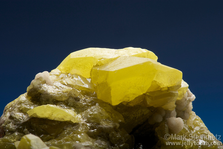 Close-up of sulfur crystals with aragonite. Cianciana Mine, Agrigento Province, Sicily, Italy.
