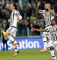 Calcio, Champions League: Gruppo D - Juventus vs Siviglia. Torino, Juventus Stadium, 30 settembre 2015.  <br /> From left, Juventus&rsquo;s Hernanes, Simone Zaza and Patrice Evra celebrate at the end of the Group D Champions League football match between Juventus and Sevilla at Turin's Juventus Stadium, 30 September 2015. Juventus won 2-0.<br /> UPDATE IMAGES PRESS/Isabella Bonotto