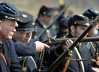 BENSALEM, PA - APRIL 5:  A Union soldier fires during a  Civil War reenactment of the battle of the Overland Campaign of 1864 at Neshaminy State Park April 5, 2014 in Bensalem, Pennsylvania.(Photo by William Thomas Cain/Cain Images)