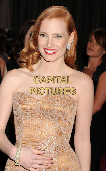 Jessica Chastain (wearing Armani Prive).85th Annual Academy Awards held at the Dolby Theatre at Hollywood & Highland Center, Hollywood, California, USA..February 24th, 2013.oscars half length blush strapless dress gown sweetheart neckline gold sparkly headshot portrait red lipstick hand arm bracelet .CAP/ROT/TM.©Tony Michaels/Roth Stock/Capital Pictures