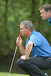 Ryder Cup 206 K Club, Straffan, Ireland..European Ryder Cup team players Darren Clarke and Lee Westwood line up their putt on the 4th green during the morning fourballs session of the 2nd day of the 2006 Ryder Cup at the K Club in Straffan, Co Kildare, in the Republic of Ireland, 23 September 2006...Photo: Eoin Clarke/ Newsfile.