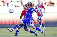 Kansas City Wizards defender Michael Harrington defends against  CD Chivas USA midfielder Michael Lahoud. The Kansas City Wizards defeated CD Chivas USA 2-0 at Home Depot Center stadium in Carson, California on Sunday September 19, 2010.