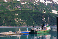 Russian family mends drift net for commercial salmon fishing with a bowpicker, Whittier, Alaska