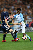 Melbourne, 17 December 2016 - LEIGH BROXHAM (6) of the Victory and BRUCE KAMAU (11) of Melbourne City compete for the ball in the round 11 match of the A-League between Melbourne City and Melbourne Victory at AAMI Park, Melbourne, Australia. Victory won 2-1 (Photo Sydney Low / sydlow.com)