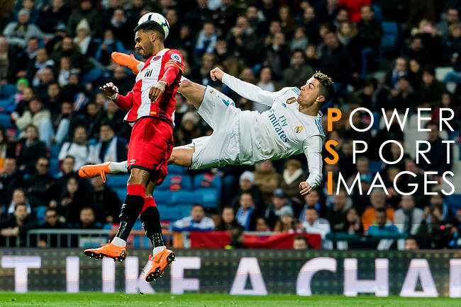 Cristiano Ronaldo of Real Madrid (R) fights for the ball with  Jonas Ramalho Chimeno of Girona FC (L) during the La Liga 2017-18 match between Real Madrid and Girona FC at Estadio Santiago Bernabéu  on March 18 2018 in Madrid, Spain. Photo by Diego Souto / Power Sport Images