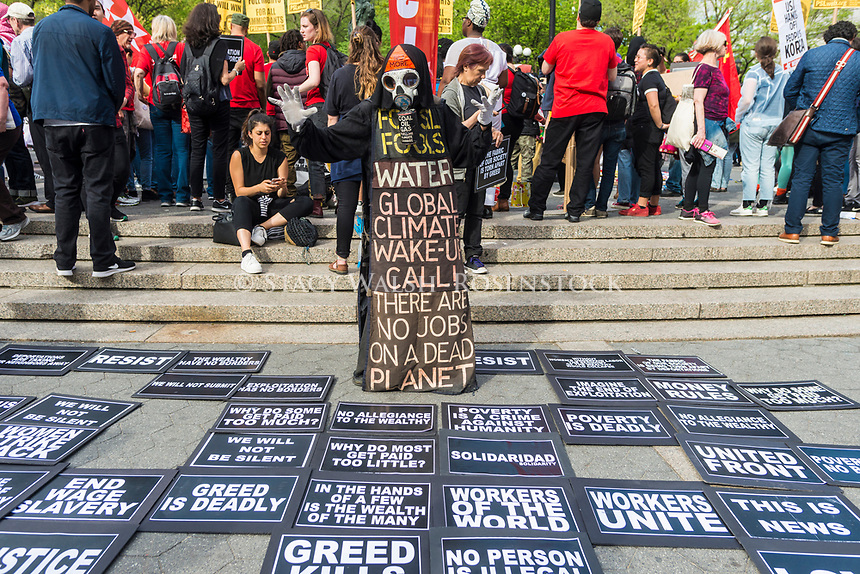 New York, NY 1 May 2017 - A Toxic Harbinger of Death, the Grim reaper, overlooks various demands and socialist issues at a May Day rally for IInternational Workers Day in Union Square Park. ©Stacy Walsh Rosenstock/Alamy