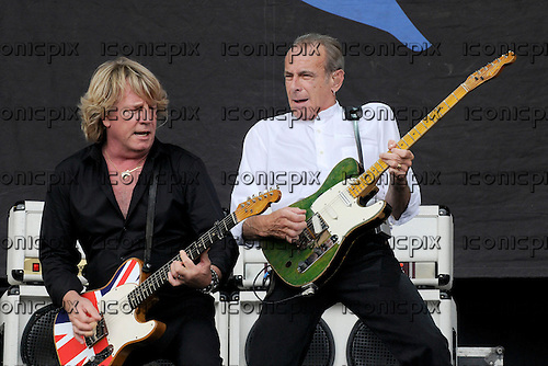 Status Quo - guitarist Rick Parfiti and vocalist Francis Rossi performing live on Day 3 on the Pyramid Stage at the 2009 Glastonbury Festival Pilton Somerset UK - 28 Jun 2009.  Photo by: George Chin / IconicPix