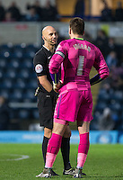 Referee Darren Drysdale talks with Goalkeeper Matt Ingram of Wycombe Wanderers during the Sky Bet League 2 match between Wycombe Wanderers and Crawley Town at Adams Park, High Wycombe, England on 28 December 2015. Photo by Andy Rowland / PRiME Media Images