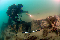 BNPS.co.uk (01202 558833)<br /> Pic: MikePitts/BU/BNPS<br /> <br /> The skeleton of the wrecked ship emerges from the seabed.<br /> <br /> Fascinating artefacts salvaged from a historic gun ship which sunk off the British coast 261 years ago have gone on display for the first time.<br /> <br /> The French built ship is credited with transforming the Georgian Royal Navy after its capture in 1747 when trials revealed it was sleeker and better armed than British warships of the day.<br /> <br /> Unfortunately HMS Invincible  became wrecked on a shallow sand bank in the Solent in 1758 when en route to fhelp fight the French in Canada.<br /> <br /> The wreck, which is three nautical miles from Portsmouth, Hants, was first discovered by a fisherman in shallow 25ft waters 40 years ago. However, changing sea bed levels in the past few years have left it more exposed to the elements, leading to fears the relics could deteriorate.<br /> <br /> This prompted archaeologists to carry out a full scale excavation, with 1,458 dives taking place between 2017 and 2019 - during which nearly 2,000 artefacts were recovered.<br /> <br /> The array of new finds, including the ship's enormous cutwater - the forward curve of the ship's stem - have now been unveiled at the MAST Archaeological Centre in Poole, Dorset. They will eventually go on display at the National Museum of the Royal Navy in Portsmouth.<br /> <br /> Mr Pascoe said the HMS Invincible's innovative longer, streamlined design was copied by the British who adopted it on their ships up until the Battle of Trafalgar (1805).