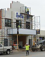 NWA Democrat-Gazette/ANDY SHUPE<br /> Workers continue to put the finishing touches Friday, Aug. 11, 2017, on The Apollo on Emma  on Emma Avenue in Springdale. The event space plans to open Thursday.