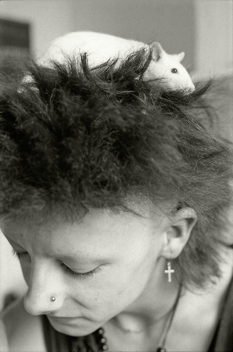 A young man with his pet rat. England 1984.