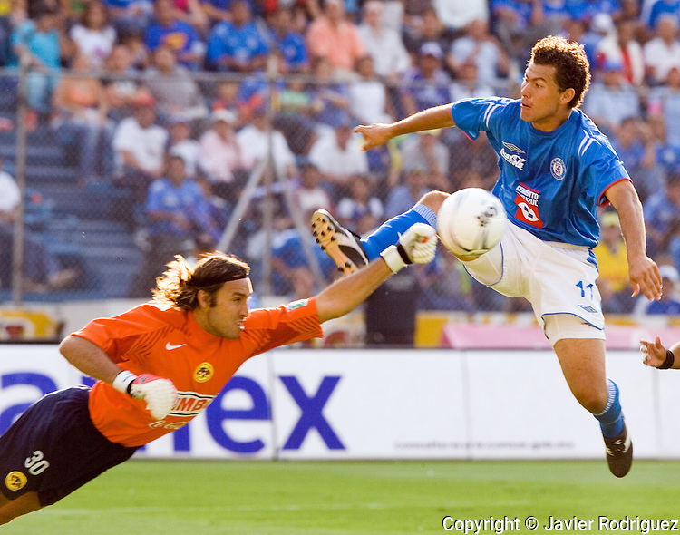 Cruz Azul forward Miguel Sabah jumps for the ball over America Aguilas goalkeeper Armando Navarrete during their soccer match at the Azul Stadium in Mexico City, April 15, 2006. America won 3-1 to Cruz Azul. Photo by © Javier Rodriguez