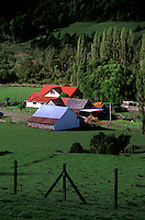 RED ROOFED FARM HOUSE and barn on CHILOE ISLAND - CHILE