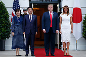 US President Donald J. Trump (2-R) and First Lady Melania Trump (R) greet Japanese Prime Minister Shinzo Abe (L) and First Lady Akie Abe (2-L) at the South Portico of the White House in Washington, DC, USA, 26 April 2019. President Trump is hosting a dinner for Prime Minister Abe and his wife celebrating First Lady Melania Trump's 49th birthday.<br /> Credit: Shawn Thew / Pool via CNP