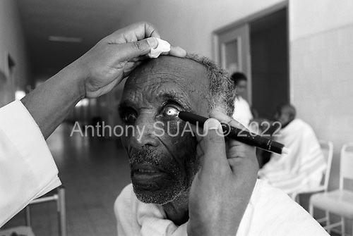Asmara, Eritrea.November 2002.Birhan Aim Hospital  (Light to the Eye Hospital)..Dr. Desbele Ghebreghergis examines each patients the day after the cataract operation. Normally, it is at this time that the patient will see light for the first time with the eye.