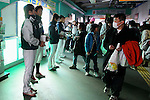 March 19th 2011 - Members of the Seibu Lions professional basebal team collect money in Tokorozawa Station, Saitama Prefecture, Japan, for victims of the 2011 Tohoku earthquake and tsunami. It is estimated that around 500,000 people were left without homes by the tsunami and earthquake and many of these are still without adequate supplies and heating. The Japanese baseball season was scheduled to start on March 25th and is divided into two leagues. Currently there is much debate as to whether it is right to start so soon after the earthquake and tsunami that devastated north eastern Japan with one leage wanting to postpone the start and the other wishing to go ahead. (Photo: Yusuke Nakanishi/Aflo)