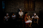 Restaurant workers take a break in Beijing, China on Thursday, August 7, 2008. The city of Beijing is gearing up for the opening ceremonies of the Olympic Games.  Kevin German