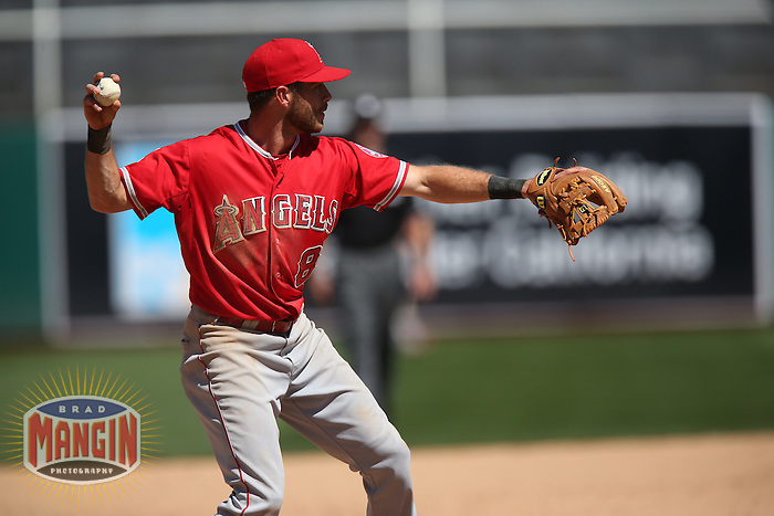 OAKLAND, CA - APRIL 30:  Taylor Featherston #8 of the Los Angeles Angels makes a play at third base against the Oakland Athletics during the game at O.co Coliseum on Thursday, April 30, 2015 in Oakland, California. Photo by Brad Mangin