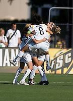 Aya Miyama (8) jumps onto her teammates after the LA Sol goal. Los Angeles Sol defeated FC Gold Pride 2-0 at Buck Shaw Stadium in Santa Clara, California on May 24, 2009.