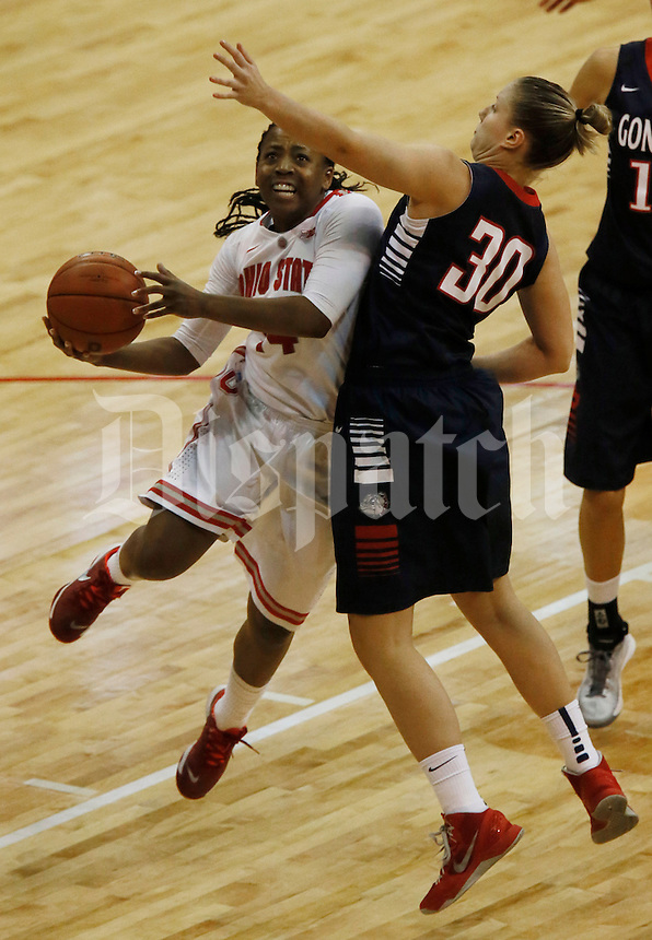 Ohio State Buckeyes guard Ameryst Alston (14) drives on Gonzaga Bulldogs center Stephanie Golden (30) at Value City Arena in Columbus Dec. 8, 2013.(Dispatch photo by Eric Albrecht)