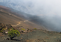 Hiking trail in the crater of HALEAKALA NATIONAL PARK on Maui in Hawaii is obscured in clouds