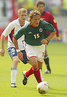 Luis Hernandez dribbles the ball upfield as John O'Brien watches. The USA defeated Mexico 2-0 in the Round of 16 of the FIFA World Cup 2002 in South Korea on June 17, 2002.