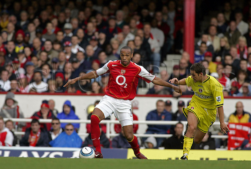 2 October 2004: Arsenal striker THIERRY HENRY competes with Luke Young for the ball during the Premier League match between Arsenal and Charlton. Arsenal beat Charlton Athletic 4-0 in the game played at Highbury Photo: Action Plus...041002 football soccer premiership premier league player
