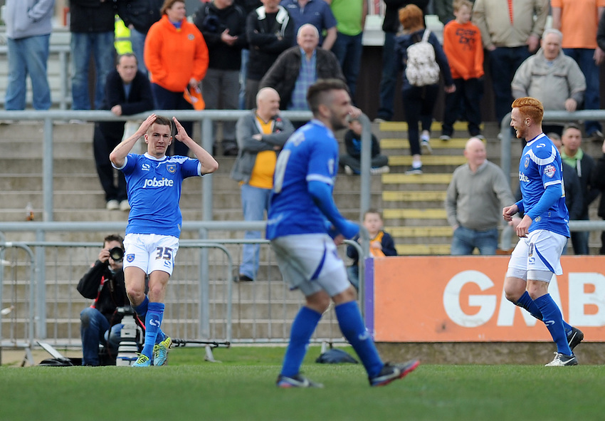 Portsmouth's Jed Wallace celebrates scoring his sides second goal <br /> <br /> Photo by Ashley Crowden/CameraSport<br /> <br /> Football - The Football League Sky Bet League Two - Newport County AFC v Portsmouth - Saturday 29th March 2014 - Rodney Parade - Newport<br /> <br /> &copy; CameraSport - 43 Linden Ave. Countesthorpe. Leicester. England. LE8 5PG - Tel: +44 (0) 116 277 4147 - admin@camerasport.com - www.camerasport.com