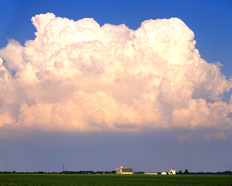 Cumulus cloud formations over a farm in northern Illinois; LaSalle County, IL
