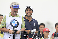 Alexander Levy (FRA) and caddy Bo all smiles on the 15th tee during Saturay's Round 3 of the 2014 BMW Masters held at Lake Malaren, Shanghai, China. 1st November 2014.<br /> Picture: Eoin Clarke www.golffile.ie