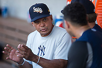 Baseball Hall of Fame member and current New York Yankees consultant Reggie Jackson (left) has a discussion with catcher Gary Sanchez (right) during the game against the Charlotte Knights at BB&T BallPark on July 20, 2016 in Charlotte, North Carolina.  The RailRiders defeated the Knights 14-2.  (Brian Westerholt/Four Seam Images)