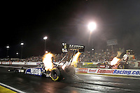 Apr. 5, 2013; Las Vegas, NV, USA: NHRA top fuel dragster driver Antron Brown (near) races alongside Terry McMillen during qualifying for the Summitracing.com Nationals at the Strip at Las Vegas Motor Speedway. Mandatory Credit: Mark J. Rebilas-