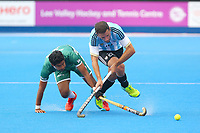 Muhammad Arsian Qadir of Pakistan tackles Manuel Brunet of Argentina during the Hockey World League Quarter-Final match between Argentina and Pakistan at the Olympic Park, London, England on 22 June 2017. Photo by Steve McCarthy.