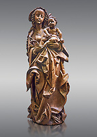 "Wooden Gothic sculpture of the Virgin and Child attributeed to Martin Hoffman from the city of Basle, 1507, Switzerland. From the Commandry of Isenheim, Haut Rhin. This sculpture is probably the ""big and ancient wooden statue of the Virgin"" cited in 1793 in the inventory of the property of the Commandry of Isenheim.  The vervatious deep folds in the Virgins dress, the laughing child Jesus  and the style of Mary were repeatedly imitated in Basel at the beginning of the sixteenth century. This masterpiece of the German late Gothic sculpture was executed in a Basel workshop and can be attributed to Martin Hoffman. Expressive and enigmatic, the style of this masterpiece is the heir of the sculpture schools of Stragbourg and Veit Stoss Franconian art.  Inv RF 1833 The Louvre Museum, Paris."