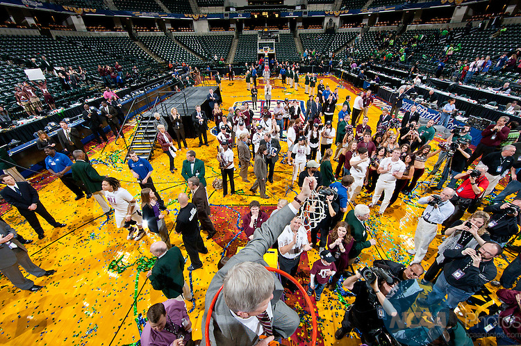 05 APR 2011:  Texas A&M University takes on Notre Dame University during the Division I Women's Basketball Championship held at Conseco Field in Indianapolis, IN.The Aggies of Texas A&M defeated the Fighting Irish of Notre Dame 76-70.  Coach Gary Blair of the Texas A&M Aggies cuts down the net and shimmies into the rim during the post-game celebration of his team's first National Championship. Jamie Schwaberow/NCAA Photos