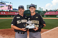 Carter Kieboom (22) of Walton High School in Marietta, Georgia poses for a photo with Steve Bernhardt after being presented with his teams Most Valuable Player Award after the Under Armour All-American Game on August 15, 2015 at Wrigley Field in Chicago, Illinois. (Mike Janes/Four Seam Images)