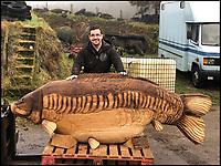 Roe-din? - Half ton Carp created from tree trunk.